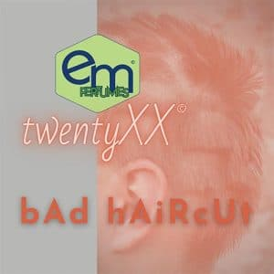 emPERFUMES and twentyXX logos on top of 1/3 gray rectangle and 2/3 photo of man with chunks of hair shaved from his head. Name of perfume bAd hAiRcUt.